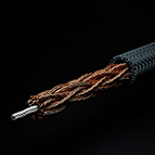 Pictured above is the C-MARC™ Hook-up Wire, Large. It is highly flexible and features 192 individually enameled, 0.125mm diameter copper conductors around a 100% cotton core. The copper structure is then overbraided with 100% natural, mercerized cotton fiber. No plastics throughout. The total conductive cross section of this wire is 2.304mm^2. This wire is perfect for internal signal wiring and represents a huge upgrade to existing wire technologies. Professional end prepping carried out by LessLoss Audio is available as an option for this product, as it is a true Litz wire and must be tinned prior to soldering.
