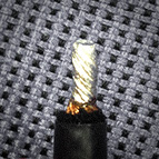 For our Hook-up wire, LessLoss offers professional end prepping using a hot soldering pot, which burns away the lacquer from all wires and fuses the endings together with solder. In this state, the wire can make direct contact or can be soldered into your application without the need for a soldering pot. This service is available only for three products: the Hook-up wire, Small; the Hook-up wire, Large; and the Bulk Coaxial cable when you choose that all wires be connected together to form a single conductor of 2.3 x 2 = 4.6mm^2 cross section. This, pictured above, is in fact how we make our C-MARC™ Loudspeaker Cable.
